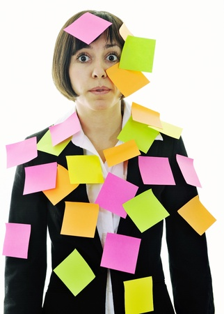 BUSY OFFICE: one frustrated young business woman with many of post it representing concept memory and frustration on work Stock Photo