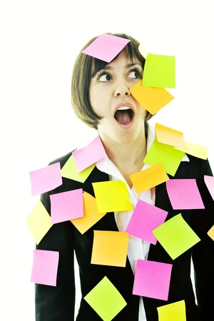 it is isolated: one frustrated young business woman with many of post it representing concept memory and frustration on work Stock Photo