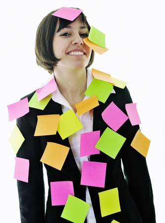 forget: one frustrated young business woman with many of post it representing concept memory and frustration on work Stock Photo