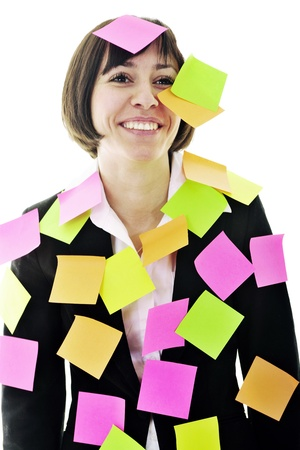 one frustrated young business woman with many of post it representing concept memory and frustration on work Stock Photo - 13280860