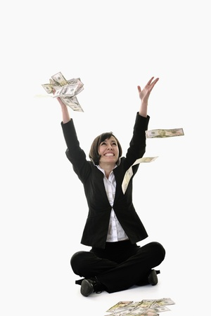 win money: happy young business woman isolated on white playing with dollars money and representing success in finance Stock Photo