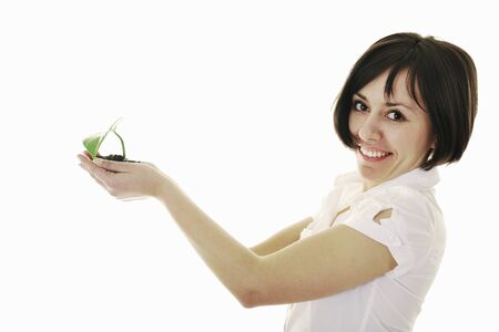 young business woman isolated on white holding green plant with small leaf and waiting to grow photo