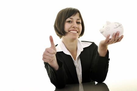 happy young business woman isolated on white puting euro money in piggy bank photo