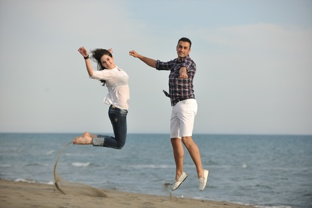 happy young couple have fun and romantic moments on beach at summer season and representing happynes and travel concept Stock Photo - 9619579