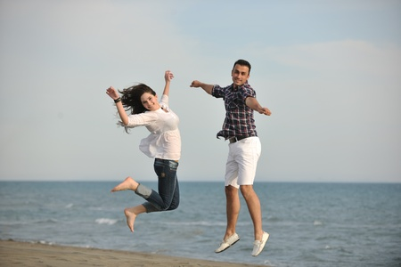 happy young couple have fun and romantic moments on beach at summer season and representing happynes and travel concept Stock Photo - 9619559