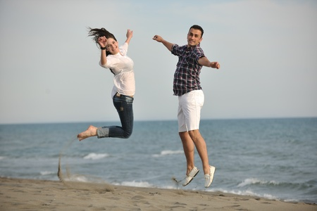 happy young couple have fun and romantic moments on beach at summer season and representing happynes and travel concept Stock Photo - 9619583
