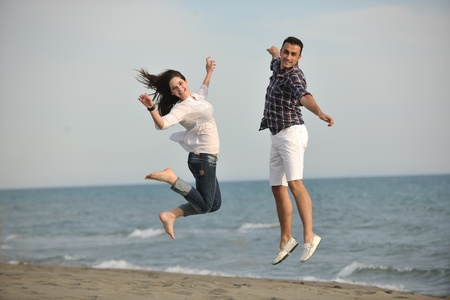 happy young couple have fun and romantic moments on beach at summer season and representing happynes and travel concept Stock Photo - 9619588