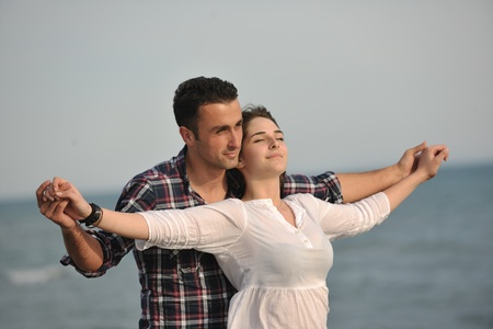 happy young couple have fun and romantic moments on beach at summer season and representing happynes and travel concept Stock Photo - 9619605