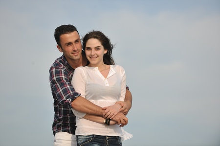 happy young couple have fun and romantic moments on beach at summer season and representing happynes and travel concept Stock Photo - 9619582
