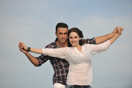 happy young couple have fun and romantic moments on beach at summer season and representing happynes and travel concept Stock Photo - 9619570