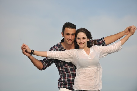 couple in summer: happy young couple have fun and romantic moments on beach at summer season and representing happynes and travel concept