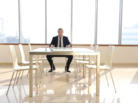 young business man lawyer with laptop alone in big bright   conference room photo