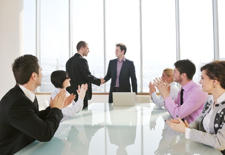 young business people group have  meeting at conference room and have discusion  about new ideas  plans and problems Stock Photo - 9619564