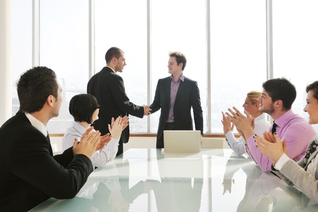 young business people group have  meeting at conference room and have discusion  about new ideas  plans and problems Stock Photo - 9619586