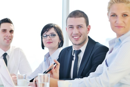 young business people group have  meeting at conference room and have discusion  about new ideas  plans and problems Stock Photo - 9619572