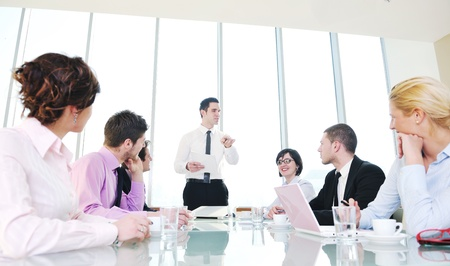 young business people group have  meeting at conference room and have discusion  about new ideas  plans and problems Stock Photo - 9619506