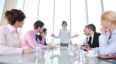 young business people group have  meeting at conference room and have discusion  about new ideas  plans and problems Stock Photo - 9619519