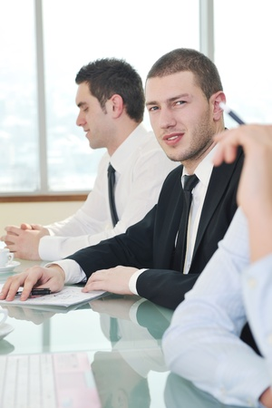 young business people group have  meeting at conference room and have discusion  about new ideas  plans and problems Stock Photo - 9619558