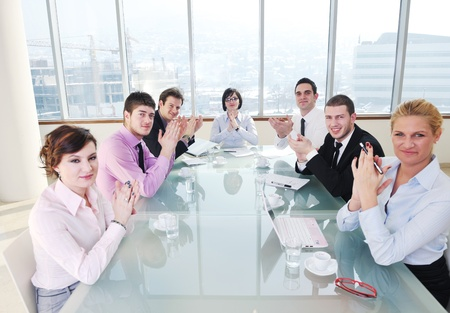 young business people group have  meeting at conference room and have discusion  about new ideas  plans and problems Stock Photo - 9619609