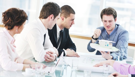 young business people group have  meeting at conference room and have discusion  about new ideas  plans and problems Stock Photo - 9619563