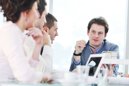 young business people group have  meeting at conference room and have discusion  about new ideas  plans and problems Stock Photo - 9619585