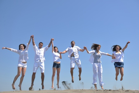 happy group: happy people group have fun  run and jump  on beach beautiful sand  beach Stock Photo