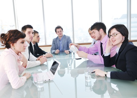 young business people group have  meeting at conference room and have discusion  about new ideas  plans and problems Stock Photo - 9619529