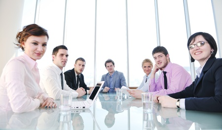 young business people group have  meeting at conference room and have discusion  about new ideas  plans and problems Stock Photo - 9619518