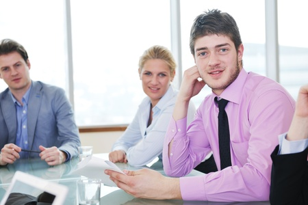 young business people group have  meeting at conference room and have discusion  about new ideas  plans and problems Stock Photo - 9619576