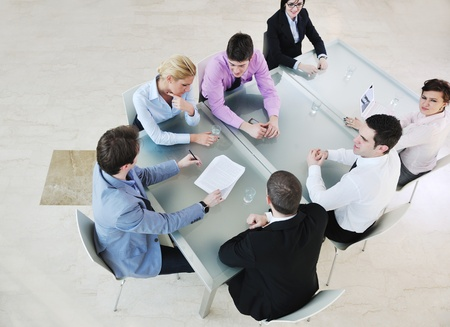young business people group have  meeting at conference room and have discusion  about new ideas  plans and problems Stock Photo - 9619501