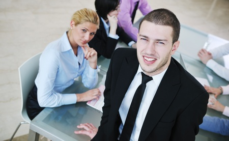 young business people group have  meeting at conference room and have discusion  about new ideas  plans and problems Stock Photo - 9619608