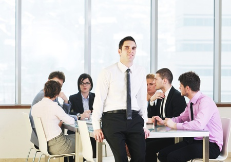 young business people group have  meeting at conference room and have discusion  about new ideas  plans and problems Stock Photo - 9619571