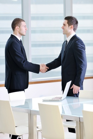 two young businessman handshake on business meeting at modern office and representing success Stock Photo - 9619488