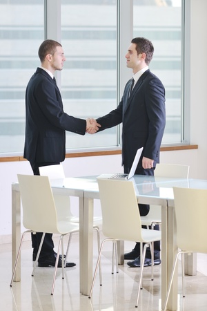 two young businessman handshake on business meeting at modern office and representing success photo