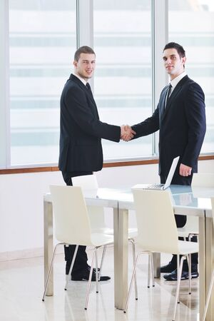 two young businessman handshake on business meeting at modern office and representing success Stock Photo - 9619489