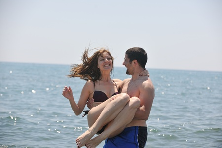 happy young couple have fun and romantic moments on beach at summer season and representing happynes and travel concept Stock Photo - 9619578