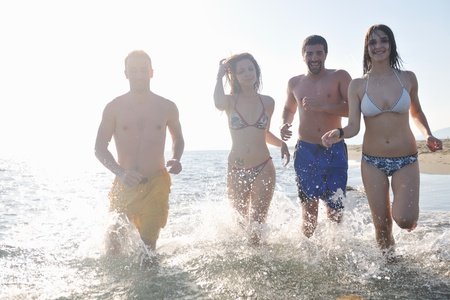 happy people group have fun  run and jump  on beach beautiful sand  beach Stock Photo - 9619639