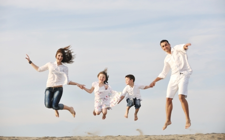 happy young family have fun and live healthy lifestyle on beach Stock Photo - 9637761