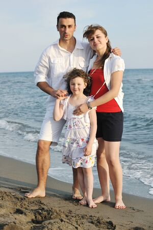 happy young family have fun and live healthy lifestyle on beach Stock Photo - 9663240