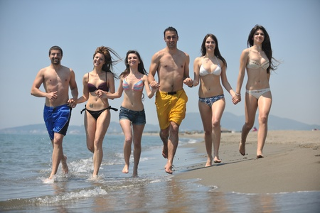 happy people group have fun  run and jump  on beach beautiful sand  beach Stock Photo - 9663236
