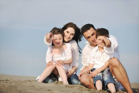 happy young family have fun and live healthy lifestyle on beach Stock Photo - 9713278