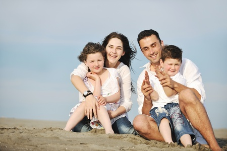 happy young family have fun and live healthy lifestyle on beach Stock Photo - 9713586