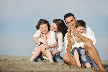 happy young family have fun and live healthy lifestyle on beach Stock Photo - 9713319