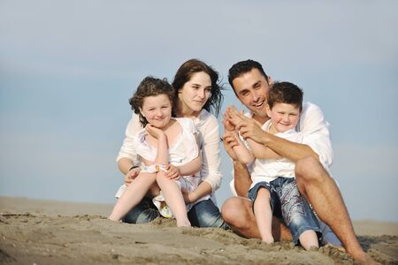happy young family have fun and live healthy lifestyle on beach Stock Photo - 9713290