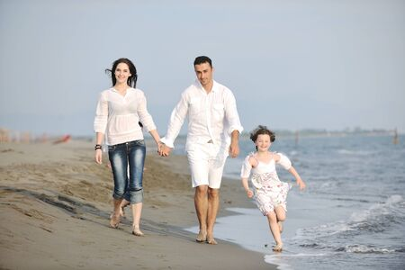 happy young family have fun and live healthy lifestyle on beach Stock Photo - 9713277