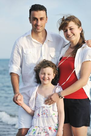 happy young family have fun and live healthy lifestyle on beach Stock Photo - 9713846