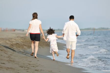 happy young family have fun and live healthy lifestyle on beach Stock Photo - 9713163