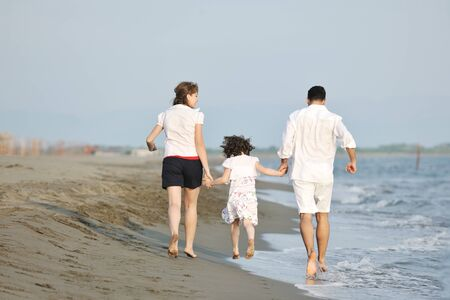 happy young family have fun and live healthy lifestyle on beach Stock Photo - 9713144