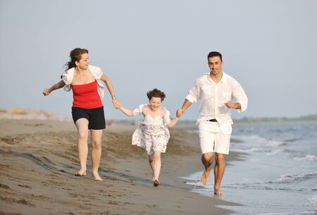happy young family have fun and live healthy lifestyle on beach Stock Photo - 9712783