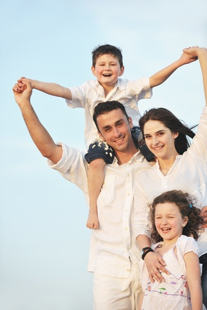 happy young family have fun and live healthy lifestyle on beach Stock Photo - 9715833